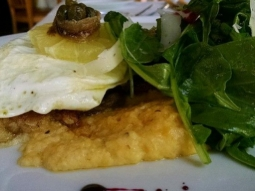 The Business Feature is wiener schnitzel. This includes a fried veal topped with a fried egg, a lemon, and anchovy wrapped capers. Is served over cheddar grits and alongside arugula with an herb vinaigrette and a beet essence with shaved Romano on top. #jacksonsrestaurant #downtownpcola #sogo #todayslunchfeature