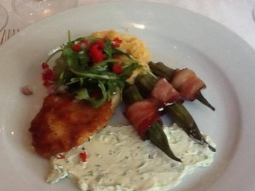 Panéed chicken breast over cheddar grits topped with arugula and tomato salad.  Served with bacon wrapped okra and jalapeño cream cheese. #jacksonsrestaurant #downtownpensacola #pensacola #sogo